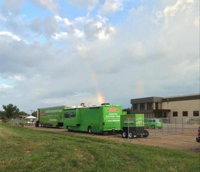 Trucks with rainbow in the background