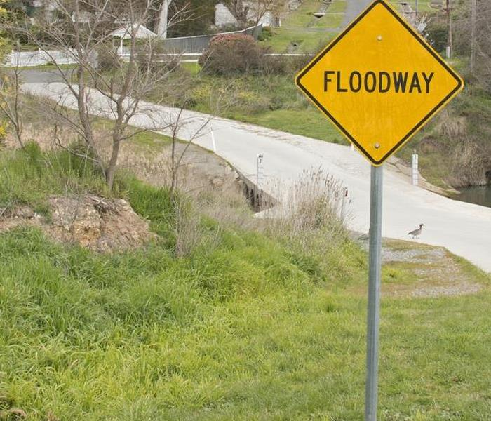 sign that says flooding area
